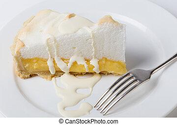 Homemade lemon meringue pie, a classic of European dessert cuisine, served with double cream