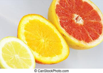Lemon, orange and grapefruit on white background