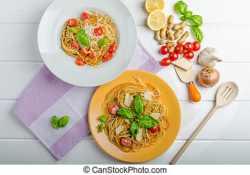 Lemon pasta with cherry tomatoes, basil and nuts