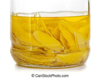 Lemon peel in fermentation - Italian alcoholic beverage -...