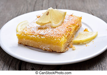 Piece of lemon pie on plate, country style