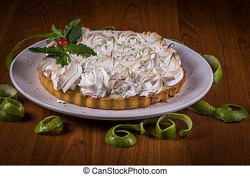 Lemon pie on wooden table.