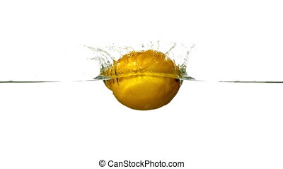 Lemon plunging into water on white background in slow motion