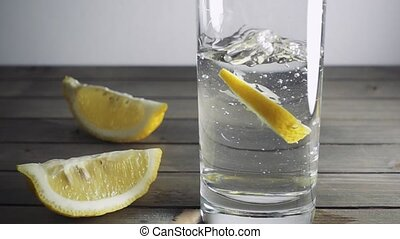Lemon silices falling into water