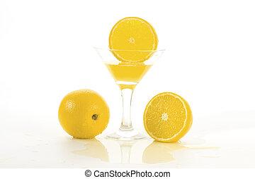 lemon slice falls in a glass