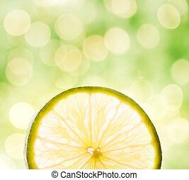 Lemon slice over abstract blurred background