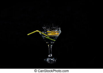 Lemon slices dropped in a glass with a cocktail