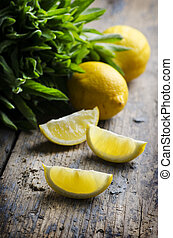 Lemon slices and spearmint on rustic wooden table