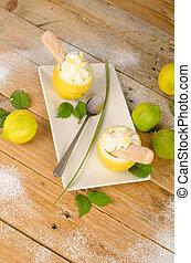 Lemon sorbet - Homemade lemon sorbed served inside an empty...