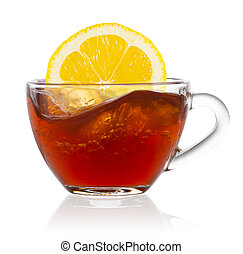 Lemon splash in transparent cup of tea