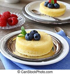 Lemon Sponge Souffl? served with berries on plate
