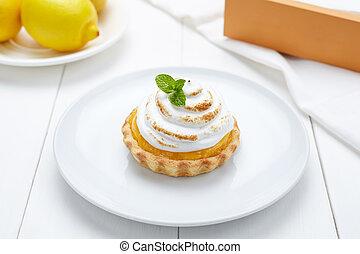 Lemon tart with whipped cream and mint sweet dessert