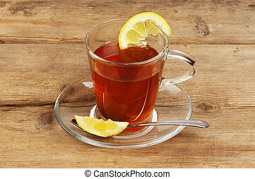 Lemon tea in a glass cup and saucer