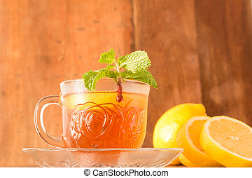 Lemon Teacup with lemon slices and mint leaf on a wooden...