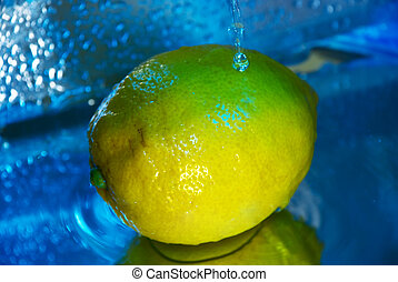lemon under running water