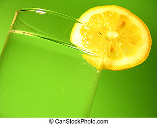 Lemon Water - A glass of carbonated water with a lemon slice...