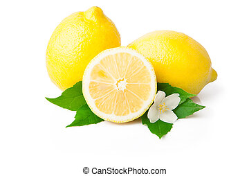 Whole lemon and half with green leafs on white background