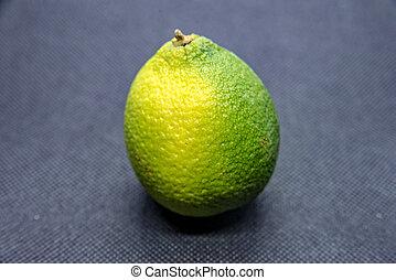 Lemon with peel on black background