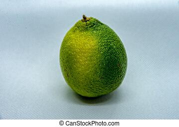 Lemon with peel on white background