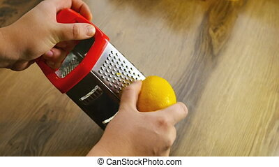 Lemon zest being grated 4k