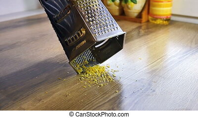 Lemon zest being grated, slow motion
