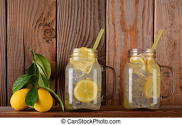 Lemonade Glasses on Shelf with Lemons - Glasses of lemonade...