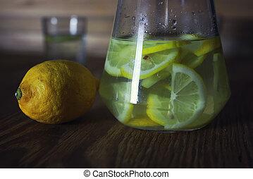 Lemonade in carafe lemon - fragrant yellow slices of lemon ...
