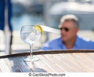 lemonade in front of man