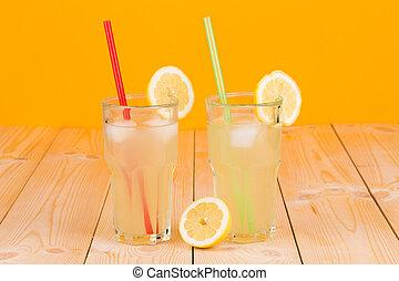 Lemonade in glasses fresh on table.