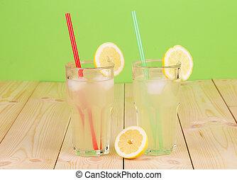 Lemonade in glasses on table.