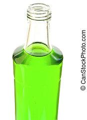 Lemonade of green color in a glass bottle