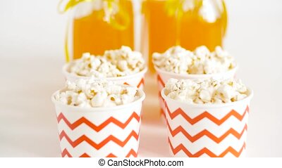 lemonade or juice in glass bottles and popcorn - drinks and...