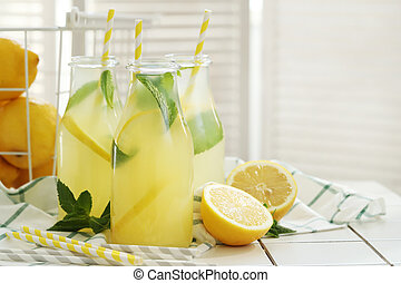 Refreshing drink - Lemonade. Refreshing drink on the table
