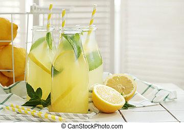 Refreshing drink - Lemonade. Refreshing drink on the table