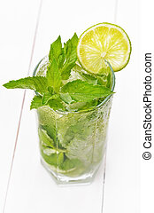 Lemonade with fresh lime and mint in glass