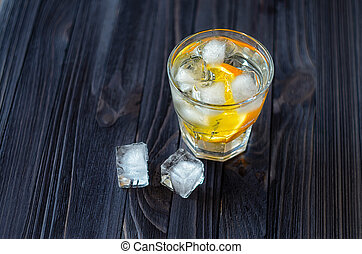 Lemonade with ice cubes and slice of orange