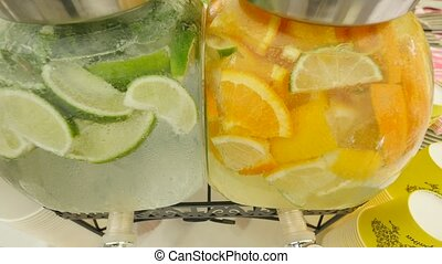 Lemonade with ice, orange and lime slices in a jar.