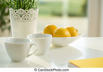 Lemons and coffee cups