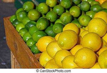 Lemons and limes at market