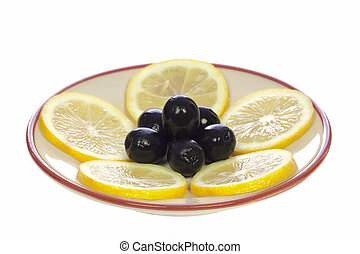 Lemons and olives on the saucer
