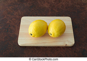 Lemons - Fresh of lemons on a rustic wooden table background...