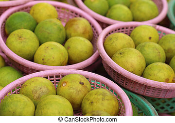Lemons in a basket at the market.