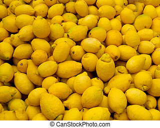 Lemons in a stack - Organic lemons with natural flaws