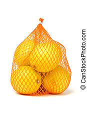 Lemons in plastic netting - Fresh lemons in plastic netting ...