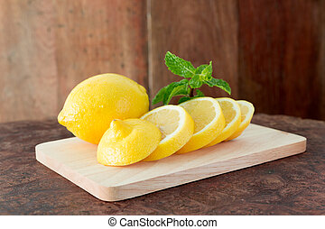 Lemons on a wooden plate