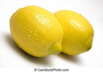 Lemons w/ Waterdrops - Two fresh looking lemons on a white ...