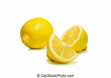 Whole and cut lemons