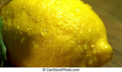 Lemons with leaves on wooden boards. - Close up of lemons...