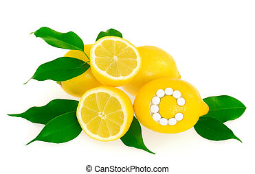 Lemons with vitamin c pills over white background - concept