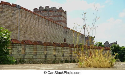 Lengthy Theodosian Walls of Constantinople with vegetation -...